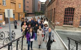 Researchers talking a walk through beautiful Trondheim